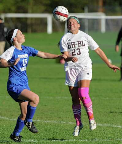 From left, Shaker's Julia Lennon tries to defend Burnt Hill's Jillian Beatty as she heads the ball during a soccer game Thursday, Oct. 11, 2012 in Burnt Hills, N.Y.  (Lori Van Buren / Times Union) Photo: Lori Van Buren