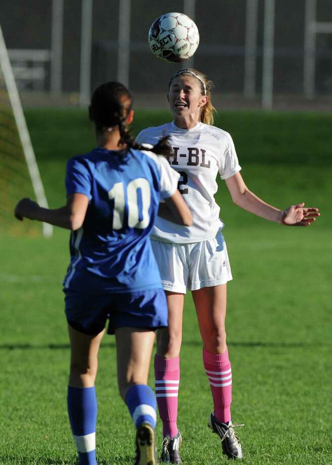 From left, Shaker's Jean Mary Chakmakas tries to defend Burnt Hill's Emma Van Vorst as she heads the ball during a soccer game Thursday, Oct. 11, 2012 in Burnt Hills, N.Y.  (Lori Van Buren / Times Union) Photo: Lori Van Buren