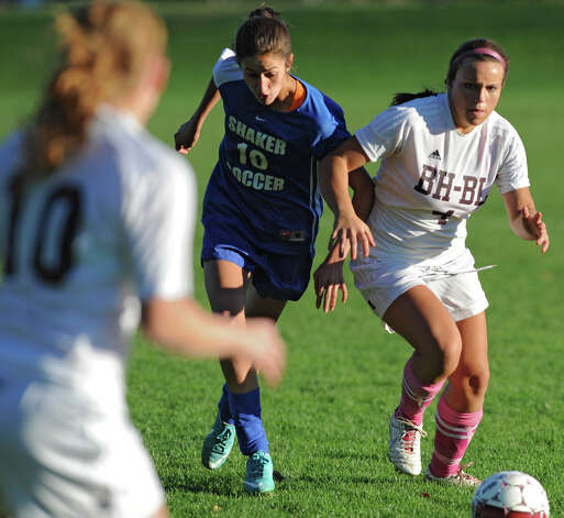 From left, Shaker's Carlie Maxwell tries to defend Burnt Hill's Marina Giorgio during a soccer game Thursday, Oct. 11, 2012 in Burnt Hills, N.Y.  (Lori Van Buren / Times Union) Photo: Lori Van Buren