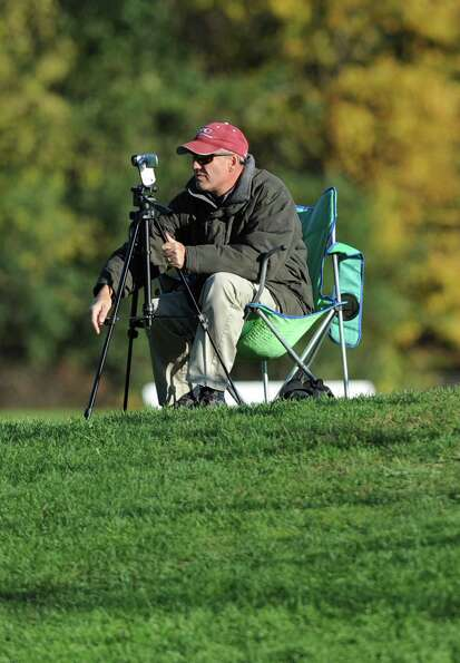 Doug Van Vorst films his daughter Emma Van Vorst's soccer game against Shaker Thursday, Oct. 11, 201