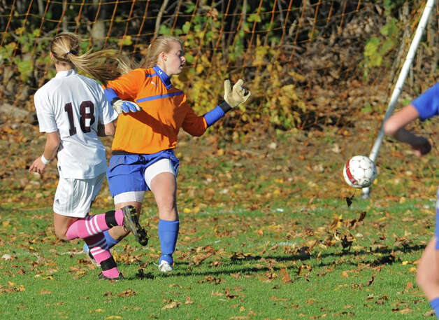 From left, Burnt Hills junior Morgan Burchhardt kicks the ball past Shaker keeper Gabby Contugno to score the first goal during a soccer game Thursday, Oct. 11, 2012 in Burnt Hills, N.Y.  (Lori Van Buren / Times Union) Photo: Lori Van Buren
