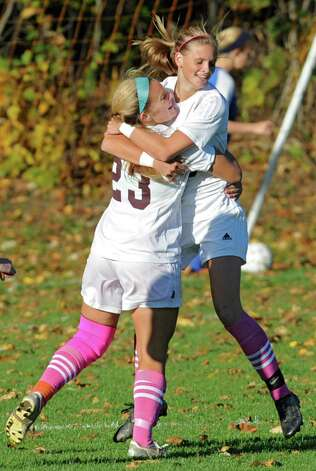 Burnt Hills captain Jillian Beatty congratulates Morgan Burchhardt, right, after scoring the first goal during a soccer game against Shaker Thursday, Oct. 11, 2012 in Burnt Hills, N.Y.  (Lori Van Buren / Times Union) Photo: Lori Van Buren