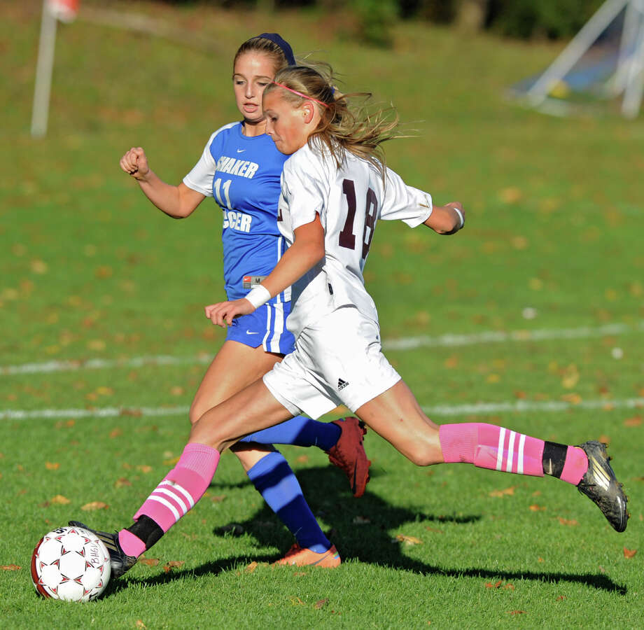 Burnt Hills junior Morgan Burchhardt runs with the ball as Shaker's McKenzie Riccio tries to defend her during a soccer game Thursday, Oct. 11, 2012 in Burnt Hills, N.Y.  (Lori Van Buren / Times Union) Photo: Lori Van Buren