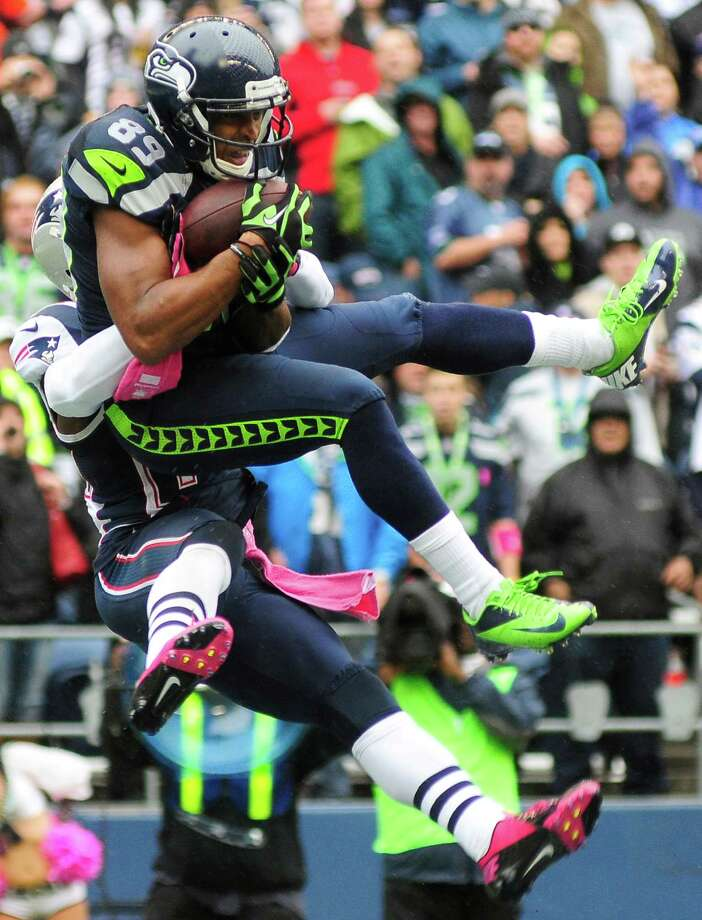 Doug Baldwin leaps into the air at the end zone for a 24-yard touchdown pass with 1:50 left in the first quarter during the Seahawks game against the Patriots at CenturyLink Field on Sunday, October 14, 2012. The Seahawks took the game 24-23. Photo: LINDSEY WASSON / SEATTLEPI.COM