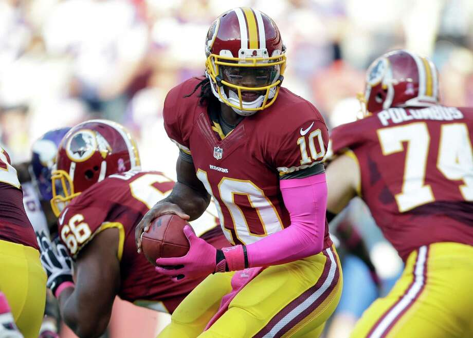 Washington Redskins quarterback Robert Griffin III (10) turns with the ball during the first half of an NFL football game against the Minnesota Vikings, Sunday, Oct. 14, 2012, in Landover, Md. (AP Photo/Pablo Martinez Monsivais) Photo: Pablo Martinez Monsivais