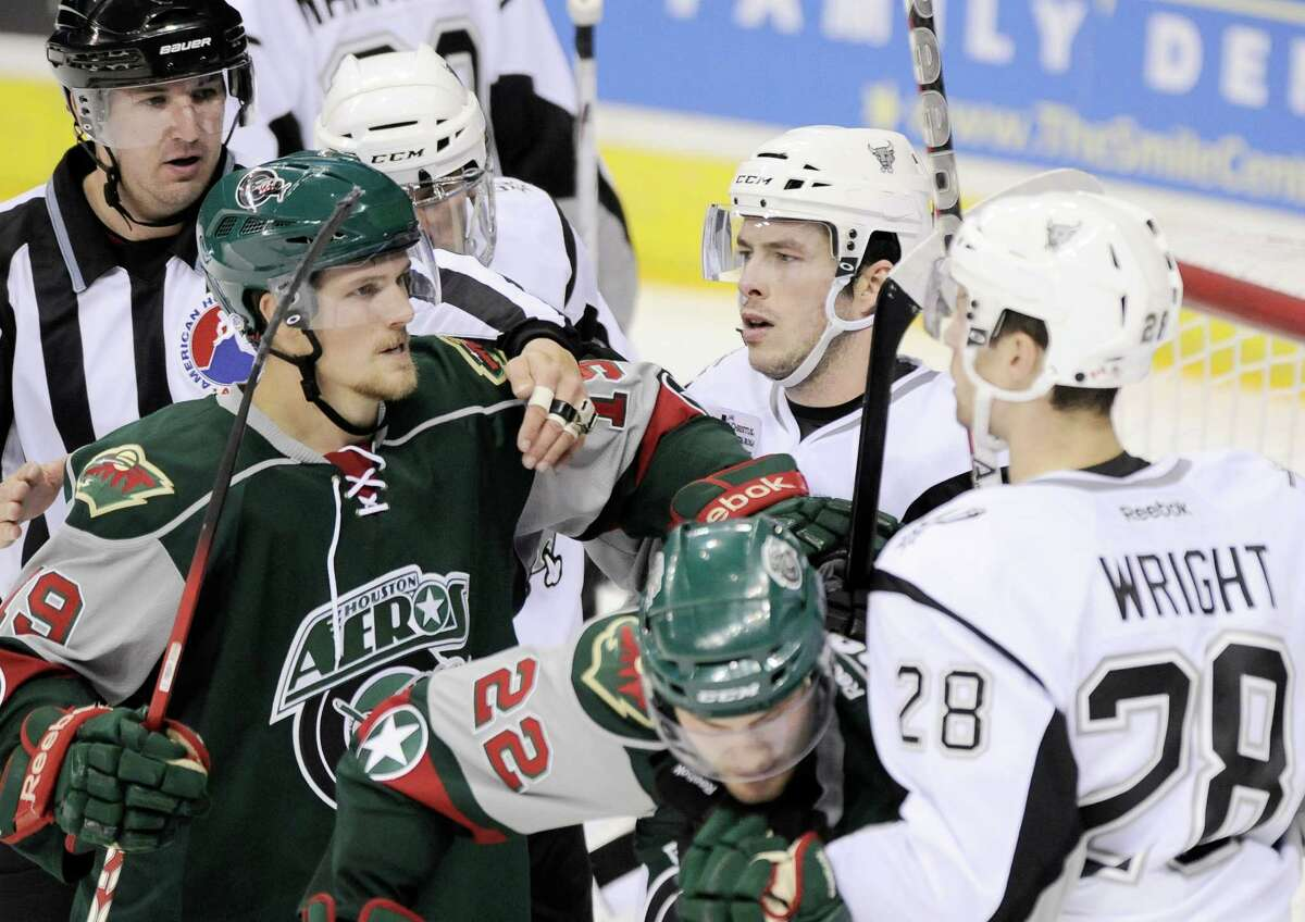 San Antonio Rampage and Houston Aeros players scrum during the third period of an AHL hockey game, Sunday, Oct. 14, 2012, in San Antonio. San Antonio won 3-2. (Darren Abate/pressphotointl.com)