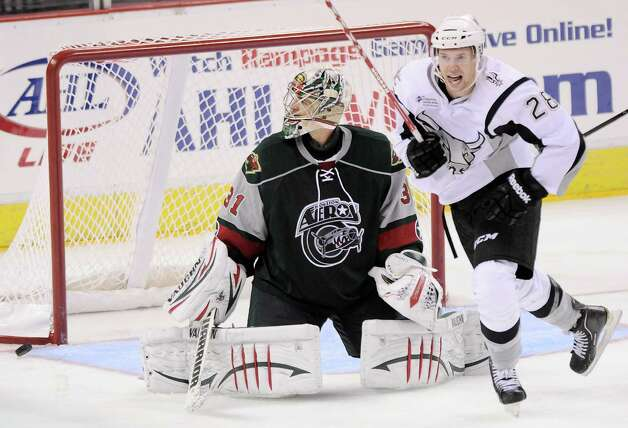 San Antonio Rampage's James Wright, right, celebrates a third-period goal in front of Houston Aeros goaltender Matt Hackett during an AHL hockey game, Sunday, Oct. 14, 2012, in San Antonio. San Antonio won 3-2. (Darren Abate/pressphotointl.com) Photo: Darren Abate, Express-News / Darren Abate/pressphotointl.com
