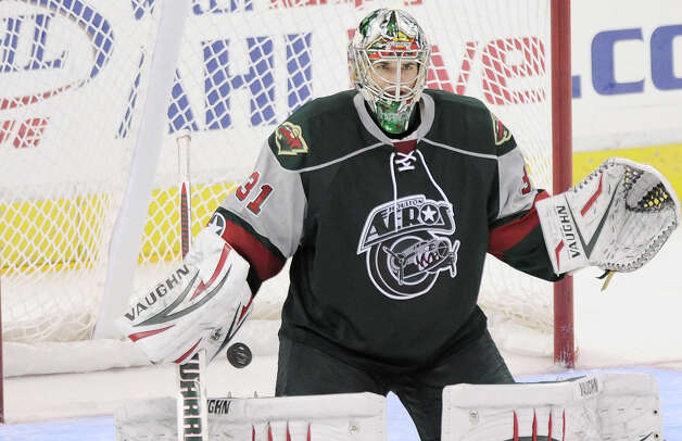 Houston Aeros goaltender Matt Hackett lets a shot through during the third period of an AHL hockey game against the San Antonio Rampage, Sunday, Oct. 14, 2012, in San Antonio. San Antonio won 3-2. (Darren Abate/pressphotointl.com) Photo: Darren Abate, Express-News / Darren Abate/pressphotointl.com