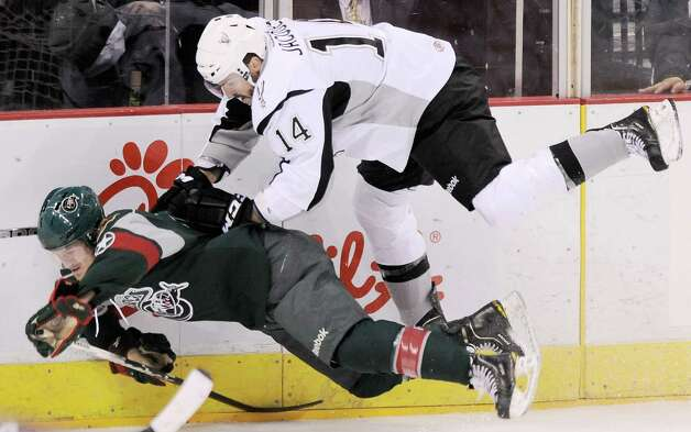 San Antonio Rampage's Jean-Francois Jacques (14) hits Houston Aeros' Jarod Palmer during the third period of an AHL hockey game, Sunday, Oct. 14, 2012, in San Antonio. San Antonio won 3-2. (Darren Abate/pressphotointl.com) Photo: Darren Abate, Express-News / Darren Abate/pressphotointl.com