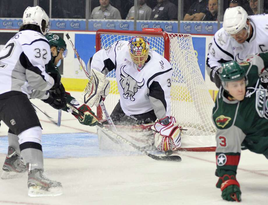 San Antonio Rampage goaltender Jacob Markstrom, center, makes a save during an AHL hockey game against the Houston Aeros, Sunday, Oct. 14, 2012, in San Antonio. San Antonio won 3-2. (Darren Abate/pressphotointl.com) Photo: Darren Abate, Express-News / Darren Abate/pressphotointl.com