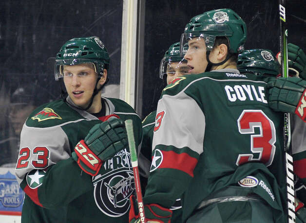 Houston Aeros players Steven Kampfer (23) and Charlie Coyle (3) celebrate a goal with teammates during an AHL hockey game against the San Antonio Rampage, Sunday, Oct. 14, 2012, in San Antonio. San Antonio won 3-2. (Darren Abate/pressphotointl.com) Photo: Darren Abate, Express-News / Darren Abate/pressphotointl.com