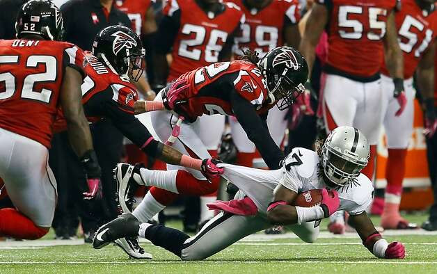 ATLANTA, GA - OCTOBER 14:  Denarius Moore #17 of the Oakland Raiders is tackled by Thomas DeCoud #28 and Asante Samuel #22 of the Atlanta Falcons at Georgia Dome on October 14, 2012 in Atlanta, Georgia.  (Photo by Kevin C. Cox/Getty Images) Photo: Kevin C. Cox, Getty Images