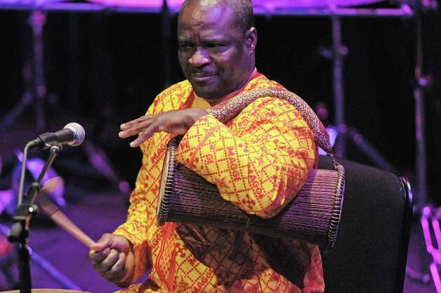 Musician Zorkie Nelson plays a talking drum  during the Drums Along the MoHu at The Egg on Sunday, Oct. 14, 2012 in Albany, NY.  The free show was part of the MoHu Arts Festival.   (Paul Buckowski / Times Union) Photo: Paul Buckowski