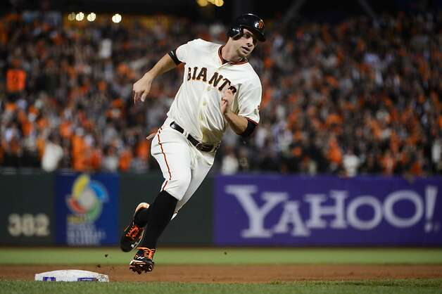 SAN FRANCISCO, CA - OCTOBER 14:  Brandon Belt #9 of the San Francisco Giants rounds third to score on a triple from Gregor Blanco #7 in the fourth during Game One of the National League Championship Series against the St. Louis Cardinals at AT&T Park on October 14, 2012 in San Francisco, California.  (Photo by Thearon W. Henderson/Getty Images) Photo: Thearon W. Henderson, Getty Images