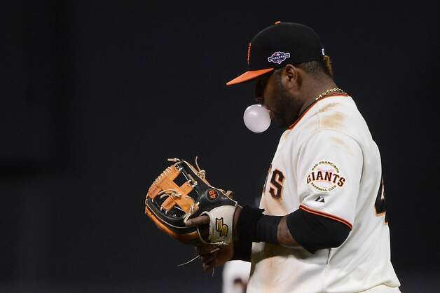 SAN FRANCISCO, CA - OCTOBER 14:  Pablo Sandoval #48 of the San Francisco Giants walks back to his position after commiting a throwing error in the eighth inning of Game One of the National League Championship Series against the St. Louis Cardinals at AT&T Park on October 14, 2012 in San Francisco, California.  (Photo by Thearon W. Henderson/Getty Images) Photo: Thearon W. Henderson, Getty Images