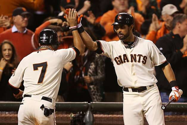 SAN FRANCISCO, CA - OCTOBER 14:  Gregor Blanco #7 of the San Francisco Giants celebrates with Angel Pagan #16 after scoring on a double by Brandon Crawford #35 in the fourth inning against the St. Louis Cardinals during Game One of the National League Championship Series at AT&T Park on October 14, 2012 in San Francisco, California.  (Photo by Ezra Shaw/Getty Images) Photo: Ezra Shaw, Getty Images