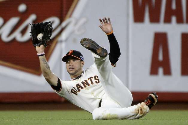 SAN FRANCISCO, CA - OCTOBER 14:  Gregor Blanco #7 of the San Francisco Giants catches a ball hit by from Skip Schumaker #55 of the St. Louis Cardinals in the sixth inning during Game One of the National League Championship Series at AT&T Park on October 14, 2012 in San Francisco, California.  (Photo by Thearon W. Henderson/Getty Images) Photo: Thearon W. Henderson, Getty Images
