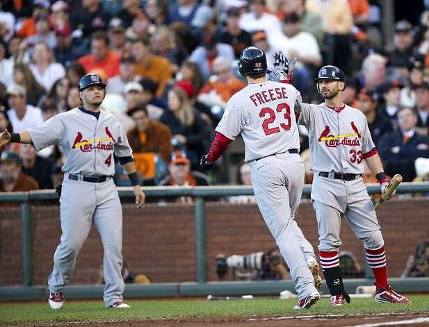 St. Louis Cardinals third baseman David Freese (23) is congratulated by second baseman Daniel Descalso (33) and catcher Yadier Molina (4) after hitting a first-inning home run Game 1 of the National League baseball championship series against the San Francisco Giants, Sunday, Oct. 14, 2012, in San Francisco. (AP Photo/The Sacramento Bee, Paul Kitagaki Jr.)  MAGS OUT; LOCAL TV OUT (KCRA3, KXTV10, KOVR13, KUVS19, KMAZ31, KTXL40); MANDATORY CREDIT Photo: Paul Kitagaki Jr., Associated Press