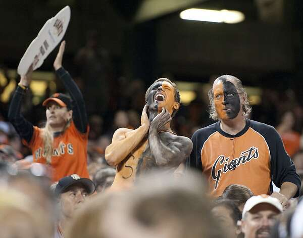 San Francisco Giants fans watch Game 1 of the National League baseball championship series between the Giants and the St. Louis Cardinals, Sunday, Oct. 14, 2012, in San Francisco. (AP Photo/The Sacramento Bee, Paul Kitagaki Jr.)  MAGS OUT; LOCAL TV OUT (KCRA3, KXTV10, KOVR13, KUVS19, KMAZ31, KTXL40); MANDATORY CREDIT Photo: Paul Kitagaki Jr., Associated Press