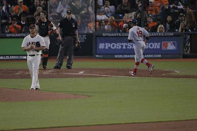 It's tough for Giants pitcher Madison Bumgarner and catcher Buster Posey to watch Jon Jay score ahead of Carlos Beltran on Beltran's two-run homer. Photo: Carlos Avila Gonzalez, The Chronicle