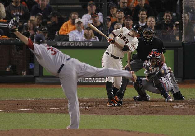 GiantsÕ first baseman Brandon Belt gets a hit in the fourth inning scoring one during game 1 of the NLCS at AT&T Park on Sunday, Oct. 14, 2012 in San Francisco, Calif. Photo: Carlos Avila Gonzalez, The Chronicle