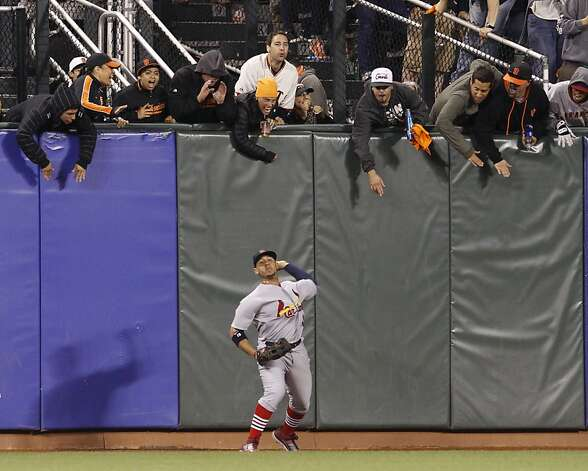 St. Louis center fielder Jon Jay throws the ball toward the infield on Gregor Blanco's two-run triple in the fourth inning. Photo: Brant Ward, The Chronicle