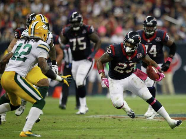 Houston Texans running back Arian Foster (23) tries to cut around Green Bay Packers free safety Morgan Burnett (42) during the second quarter at Reliant Stadium on Sunday, Oct. 14, 2012, in Houston. Photo: Brett Coomer, Houston Chronicle / © 2012  Houston Chronicle