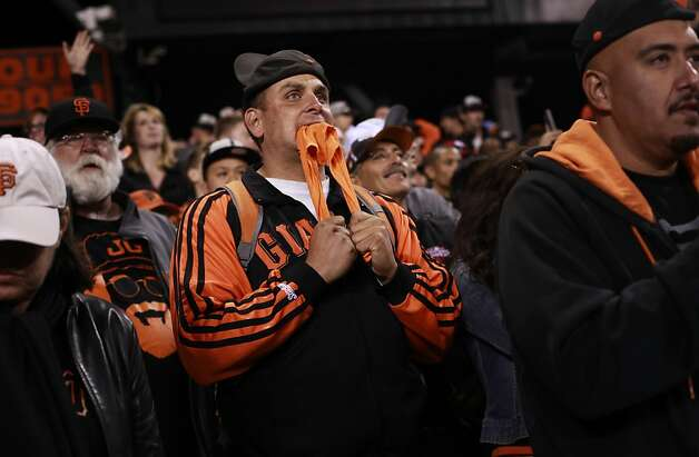 Ryan Rodriguez of Fremont bites his rally towel as the Giants' Marco Scutaro ends the game with a groundout to first. Photo: Mike Kepka, The Chronicle