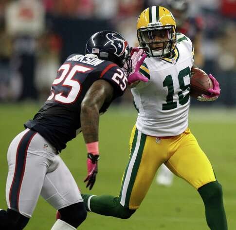 Houston Texans cornerback Kareem Jackson (25) makes a stop on Green Bay Packers wide receiver Randall Cobb (18) during the first quarter at Reliant Stadium on Sunday, Oct. 14, 2012, in Houston. Photo: Brett Coomer, Houston Chronicle / © 2012  Houston Chronicle
