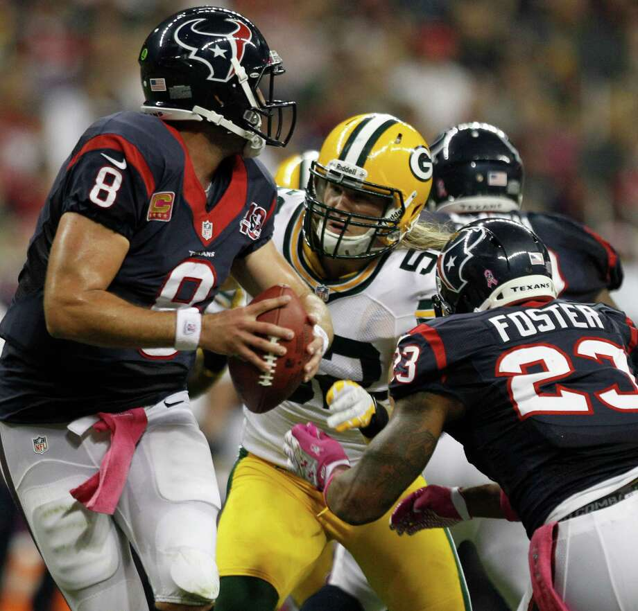 Green Bay Packers outside linebacker Clay Matthews (52) applies pressure to Houston Texans quarterback Matt Schaub (8) during the first quarter at Reliant Stadium on Sunday, Oct. 14, 2012, in Houston. Photo: Brett Coomer, Houston Chronicle / © 2012  Houston Chronicle
