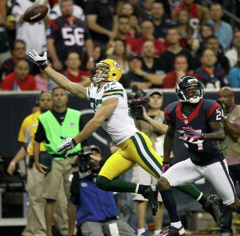 Green Bay Packers wide receiver Jordy Nelson (87) can't get his hands on a pass as Houston Texans cornerback Johnathan Joseph (24) defends during the first quarter at Reliant Stadium on Sunday, Oct. 14, 2012, in Houston. Photo: Brett Coomer, Houston Chronicle / © 2012  Houston Chronicle