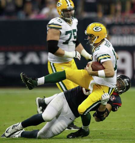 Houston Texans defensive end J.J. Watt (99) sacks Green Bay Packers quarterback Aaron Rodgers (12) during the first quarter at Reliant Stadium on Sunday, Oct. 14, 2012, in Houston. Photo: Brett Coomer, Houston Chronicle / © 2012  Houston Chronicle