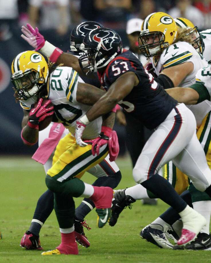 Houston Texans inside linebacker Bradie James (53) makes a stop on Green Bay Packers running back Alex Green (20) during the first quarter at Reliant Stadium on Sunday, Oct. 14, 2012, in Houston. Photo: Brett Coomer, Houston Chronicle / © 2012  Houston Chronicle