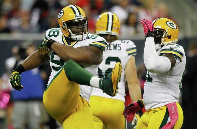 Green Bay Packers defensive end C.J. Wilson (98) celebrates after a sack of Houston Texans quarterback Matt Schaub during the first quarter at Reliant Stadium on Sunday, Oct. 14, 2012, in Houston. Photo: Brett Coomer, Houston Chronicle / © 2012  Houston Chronicle