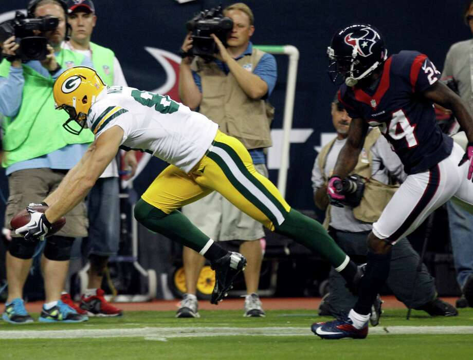 Green Bay Packers wide receiver Jordy Nelson (87) beats Houston Texans cornerback Johnathan Joseph (24) on a 41-yard touchdown reception during the first quarter at Reliant Stadium on Sunday, Oct. 14, 2012, in Houston. Photo: Brett Coomer, Houston Chronicle / © 2012  Houston Chronicle