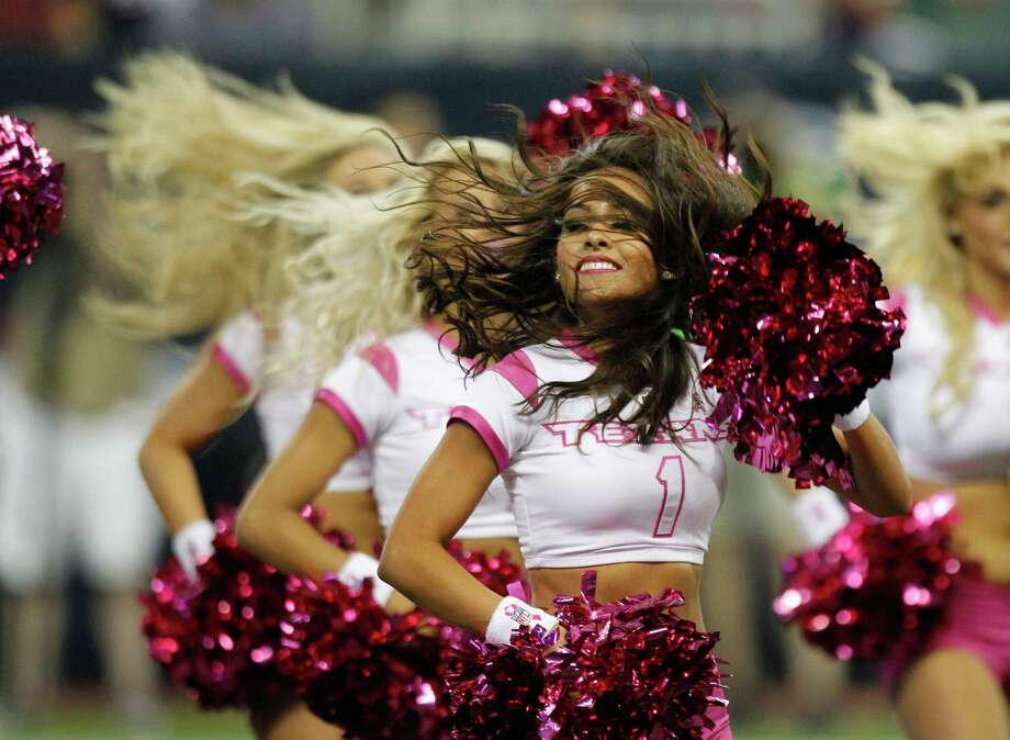 Houston Texans cheerleaders perform during the second quarter against the Green Bay Packers at Reliant Stadium on Sunday, Oct. 14, 2012, in Houston. Photo: Brett Coomer, Houston Chronicle / © 2012  Houston Chronicle
