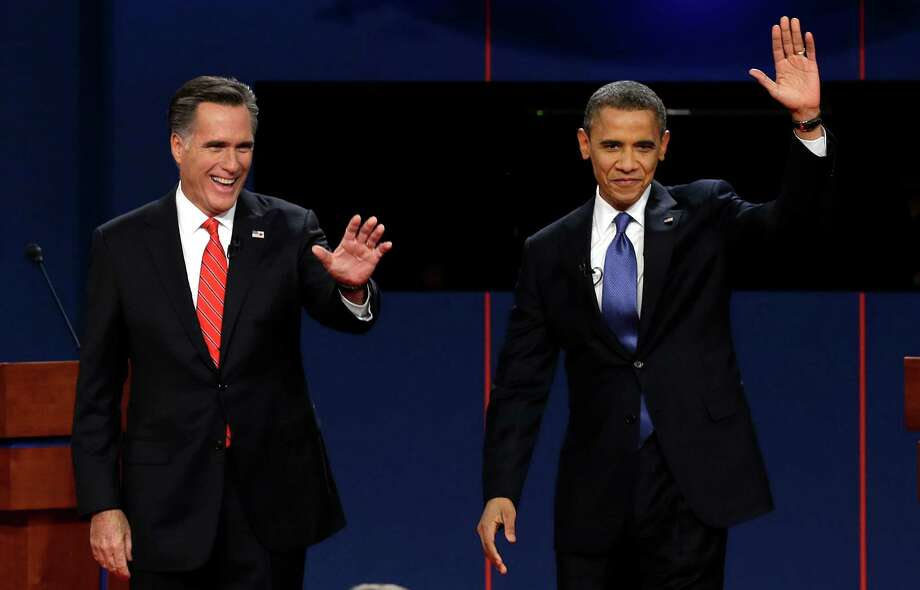 "FILE - In this Oct. 3, 2012, file photo, Republican presidential candidate Mitt Romney and President Barack Obama wave to the audience during the first presidential debate at the University of Denver in Denver. The sixth ""town hall"" style presidential debate will bring Obama and Romney to Hofstra University on New York's Long Island Tuesday, Oct. 16, 2012. They'll take questions from undecided voters selected by Gallup. (AP Photo/Charlie Neibergall, File) Photo: Charlie Neibergall / AP"