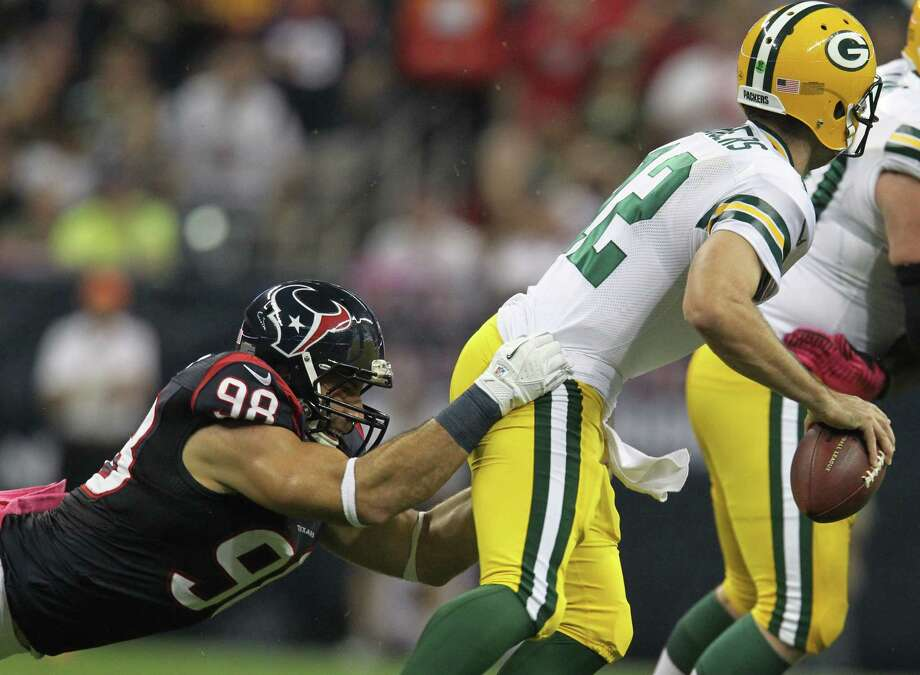 Green Bay Packers quarterback Aaron Rodgers (12) slips away from Houston Texans outside linebacker Connor Barwin (98) during the first quarter at Reliant Stadium on Sunday, Oct. 14, 2012, in Houston. Photo: Karen Warren, Houston Chronicle / © 2012  Houston Chronicle