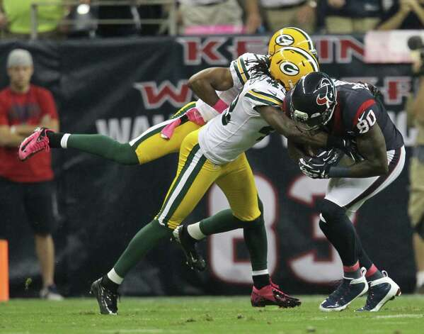 Houston Texans wide receiver Andre Johnson (80) makes a catch for a 12-yard gain as Green Bay Packers strong safety M.D. Jennings (43) defends during the first quarter at Reliant Stadium on Sunday, Oct. 14, 2012, in Houston. Photo: Karen Warren, Houston Chronicle / © 2012  Houston Chronicle