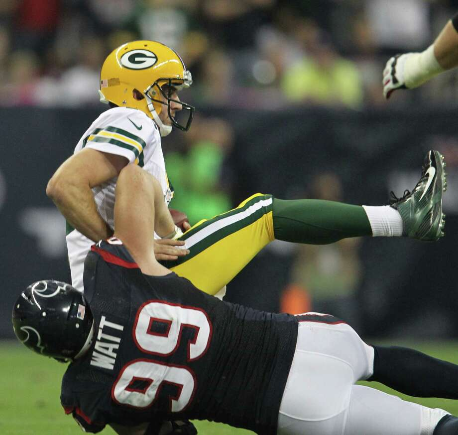 Houston Texans defensive end J.J. Watt (99) sacks Green Bay Packers quarterback Aaron Rodgers (12) during the first quarter at Reliant Stadium on Sunday, Oct. 14, 2012, in Houston. Photo: Karen Warren, Houston Chronicle / © 2012  Houston Chronicle