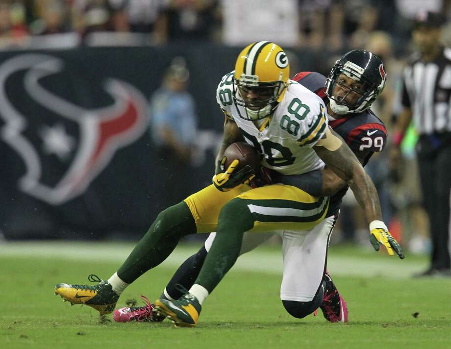 Houston Texans strong safety Glover Quin (29) brings down Green Bay Packers tight end Jermichael Finley (88) during the first quarter at Reliant Stadium on Sunday, Oct. 14, 2012, in Houston. Photo: Karen Warren, Houston Chronicle / © 2012  Houston Chronicle