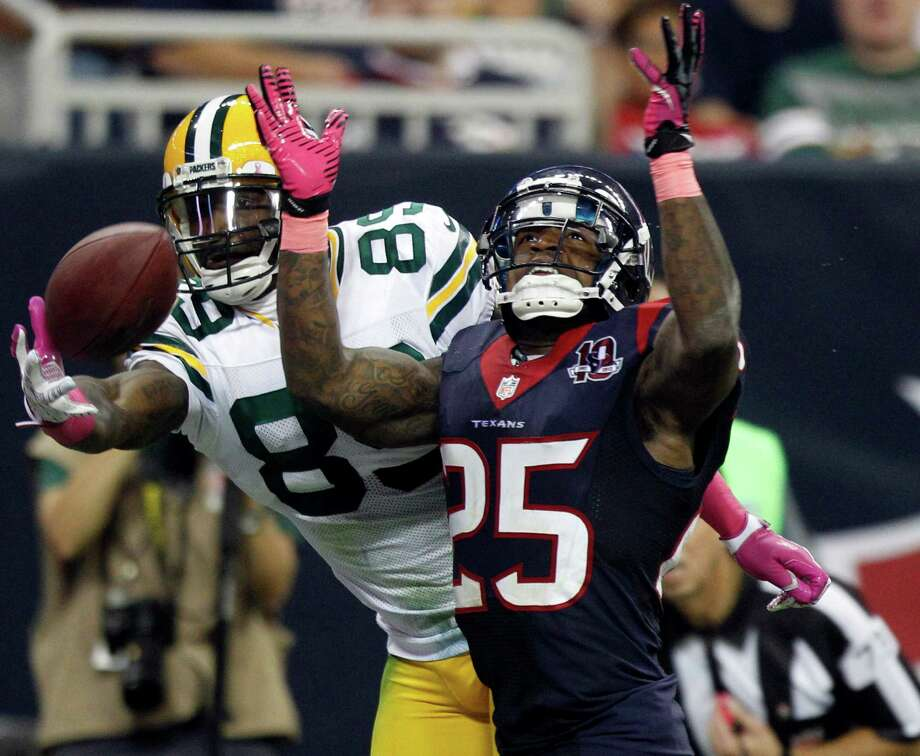 Green Bay Packers wide receiver James Jones (89) reaches for a pass as Houston Texans cornerback Kareem Jackson (25) defends during the fourth quarter at Reliant Stadium on Sunday, Oct. 14, 2012, in Houston. Photo: Brett Coomer, Houston Chronicle / © 2012  Houston Chronicle