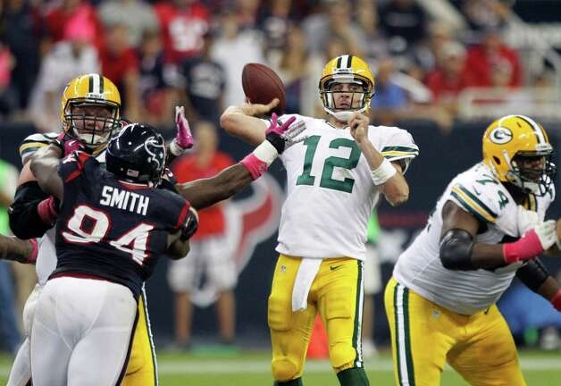 Green Bay Packers quarterback Aaron Rodgers (12) throws a pass during the fourth quarter against the Houston Texans at Reliant Stadium on Sunday, Oct. 14, 2012, in Houston. Photo: Brett Coomer, Houston Chronicle / © 2012  Houston Chronicle