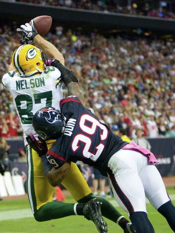 Green Bay Packers wide receiver Jordy Nelson (87) catches a touchdown pass as Houston Texans strong safety Glover Quin (29) defends during the third quarter at Reliant Stadium on Sunday, Oct. 14, 2012, in Houston. Photo: Brett Coomer, Houston Chronicle / © 2012  Houston Chronicle