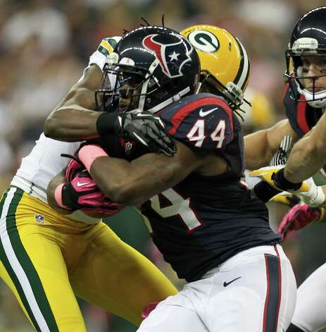 Houston Texans running back Ben Tate (44) is wrapped up by the Green Bay Packers defense during the first quarter at Reliant Stadium, Sunday, Oct. 14, 2012, in Houston. Photo: Nick De La Torre, Houston Chronicle / © 2012  Houston Chronicle