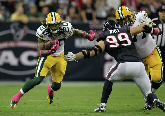 Green Bay Packers running back Alex Green (20) tries to get around Houston Texans defensive end J.J. Watt (99) during the first quarter at Reliant Stadium, Sunday, Oct. 14, 2012, in Houston. Photo: Nick De La Torre, Houston Chronicle / © 2012  Houston Chronicle