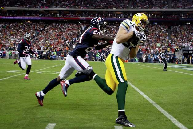 Green Bay Packers wide receiver Jordy Nelson (87) beats Houston Texans cornerback Johnathan Joseph (24) for a 41-yard touchdown during the first quarter at Reliant Stadium, Sunday, Oct. 14, 2012, in Houston. Photo: Nick De La Torre, Houston Chronicle / © 2012  Houston Chronicle