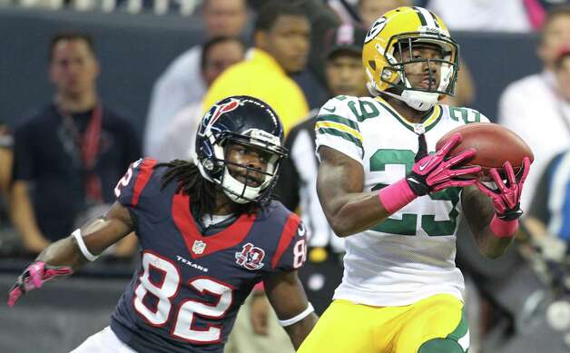 Green Bay Packers cornerback Casey Hayward (29) intercepts a pass intended for Houston Texans wide receiver Keshawn Martin (82) in the end zone during the fourth quarter at Reliant Stadium on Sunday, Oct. 14, 2012, in Houston. Photo: Karen Warren, Houston Chronicle / © 2012  Houston Chronicle