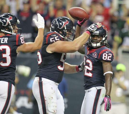 Houston Texans wide receiver Keshawn Martin (82) celebrates with center Chris Myers (55) after making a catch to set up a Texans touchdown during the third quarter against the Green Bay Packers at Reliant Stadium on Sunday, Oct. 14, 2012, in Houston. Photo: Karen Warren, Houston Chronicle / © 2012  Houston Chronicle