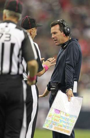 Houston Texans head coach Gary Kubiak argues with an official after Connor Barwin was called for a personal foul on a Green Bay Packers field goal attempt during the third quarter at Reliant Stadium on Sunday, Oct. 14, 2012, in Houston. Photo: Karen Warren, Houston Chronicle / © 2012  Houston Chronicle
